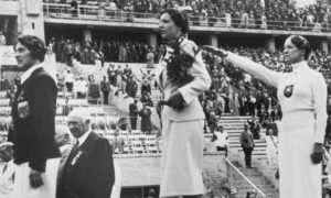 Helene Mayer on the podium at the Berlin Olympics, 1936. Helene was a German Jew. The authorities wanted to present a positive image of themselves to the world and Helene's participation was one way of doing that. She had little choice but to salute, the ramifications for her family would have been huge had she refused.